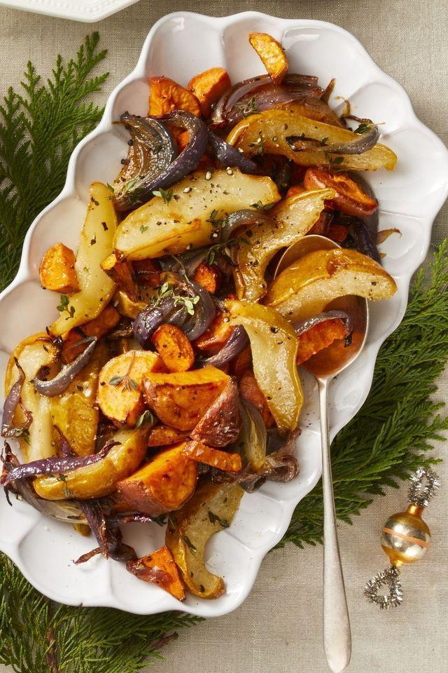 """<p>Our mantra: The more veggies on the table, the better. After all, there are only so many cookies one can consume during the holidays. This medley of root vegetables and roasted pears brings both color and fun into the spread.</p><p><em><a href=""""https://www.goodhousekeeping.com/food-recipes/a25324666/roasted-sweet-potato-pear-and-onion-recipe/"""" rel=""""nofollow noopener"""" target=""""_blank"""" data-ylk=""""slk:Get the recipe for Roasted Sweet Potato, Pear, and Onion »"""" class=""""link rapid-noclick-resp"""">Get the recipe for Roasted Sweet Potato, Pear, and Onion »</a></em> </p>"""