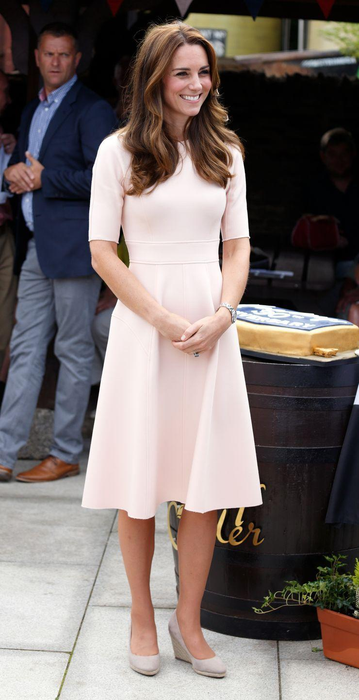"""<p>Kate wore these <a href=""""https://www.monsoonlondon.com/us/"""" rel=""""nofollow noopener"""" target=""""_blank"""" data-ylk=""""slk:Monsoon brand wedges"""" class=""""link rapid-noclick-resp"""">Monsoon brand wedges</a> for a royal visit to a cider farm. While we're all for the look, its rumored that the Queen isn't. Reportedly, HRH isn't too keen on wedges shoes, so Kate usually wears them to events where the Queen isn't present.</p>"""