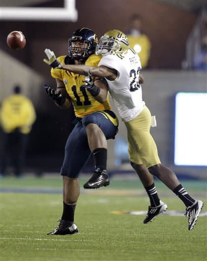 California tight end Richard Rodgers (11) makes a catch against UCLA defensive back Kenny Orjioke (23) during the first half of an NCAA college football game in Berkeley, Calif., Saturday, Oct. 6, 2012. (AP Photo/Tony Avelar)