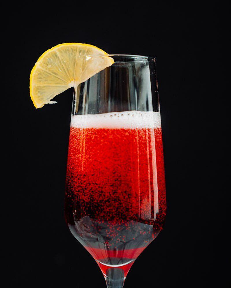 """<p>This bubbly French cocktail gets its Christmas-ready ruby red shade from black currant liqueur. </p><p><em>Get the recipe at <a href=""""https://www.acouplecooks.com/kir-royale/"""" rel=""""nofollow noopener"""" target=""""_blank"""" data-ylk=""""slk:A Couple Cooks"""" class=""""link rapid-noclick-resp"""">A Couple Cooks</a>. </em></p>"""