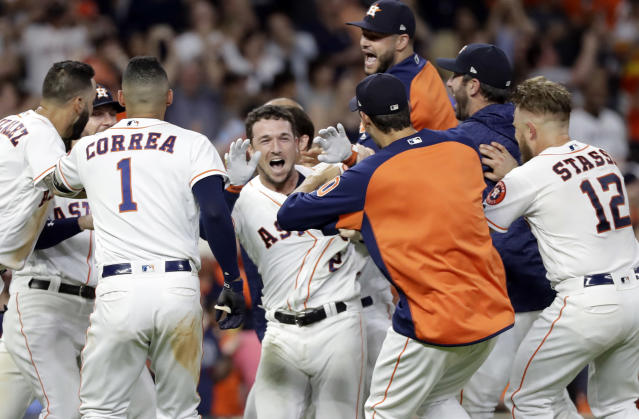 Houston Astros' Alex Bregman, center, celebrates with teammates after hitting a game-winning double to score two runs against the Tampa Bay Rays during the ninth inning of a baseball game Monday, June 18, 2018, in Houston. The Astros won 5-4. (AP Photo/David J. Phillip)