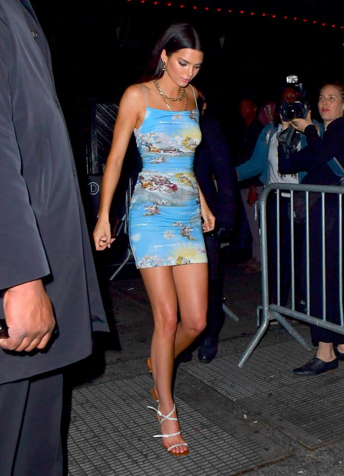 <p>Kendall Jenner slipped into a mini dress that was very on theme with its Renaissance mural-inspired print. (Photo: Splash News) </p>