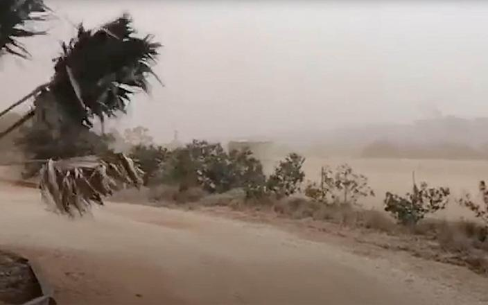 A dust storm blows across Carnarvon, western Australia, with tens of thousands left without power