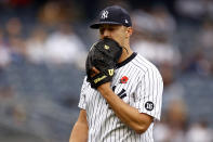 New York Yankees starting pitcher Jameson Taillon reacts while walking to the dugout during the fourth inning of a baseball game against the Tampa Bay Rays on Monday, May 31, 2021, in New York. (AP Photo/Adam Hunger)