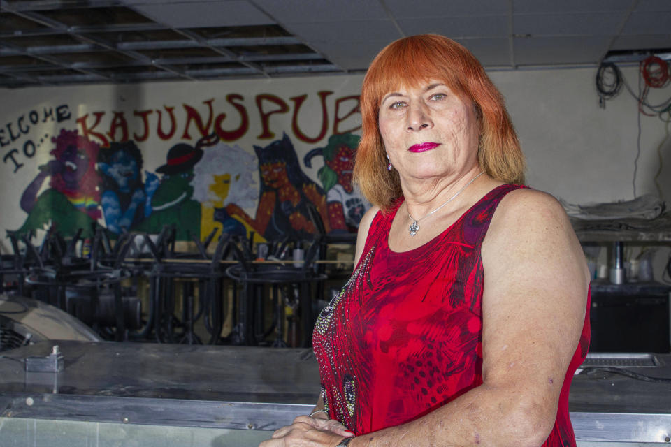 Joann Guidos, who opened Kajun's Pub on St. Claude in 2004, poses for a portrait in New Orleans, Friday, Jan. 29, 2021. Guidos closed for a few months after Hurricane Katrina hit in 2005, and then literally never closed again. The bar was open 24 hours a day, seven days a week until the pandemic. (AP Photo/Dorthy Ray)