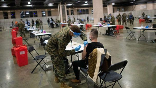 PHOTO: Military personnel administer a COVID-19 vaccine at a FEMA community vaccination center on March 2, 2021 at the Pennsylvania Convention Center in Philadelphia. (Mark Makela/Getty Images, FILE)