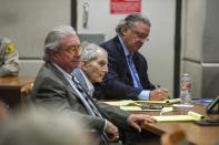 FILE - In this March 5, 2020, file photo real estate heir Robert Durst, middle, sits with his defense attorneys, David Chesnoff, left, and Dick DeGuerin during his murder trial at the Airport Branch Courthouse in Los Angeles. Fourteen months after the murder trial of New York real estate heir Durst was put on hold because of the coronavirus pandemic, jurors are returning to court to see if they can finish the assignment they were given. A Los Angeles judge will question jurors Monday, May 17, 2021, to find out if they can continue to serve in the case that is expected to last four to five months. (Robyn Beck/Pool Photo via AP, File)