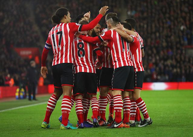<p>Team mates surround Redmond after he struck the opener (Getty Images) </p>