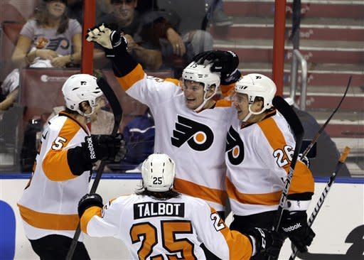Philadelphia Flyers' Tye McGinn (15) is congratulated by teammates Braydon Coburn (5) and Ruslan Fedotenko (26) after McGinn scored against the Florida Panthers during the first period of an NHL hockey game in Sunrise, Fla., Saturday, Jan. 26, 2013. (AP Photo/Alan Diaz)