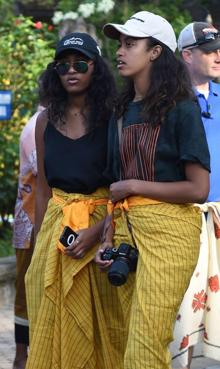 Sasha and Malia outside the temple.