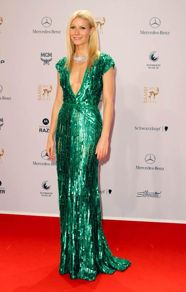 Fellow fashionista Gwyneth Paltrow lit up the arrivals line at the 2011 Bambi Awards in Wiesbaden, Germany, in a sequined, emerald green Elie Saab stunner. The statuesque Oscar winner accessorized perfectly by decorating her decolletage with a gigantic diamond necklace. (11/10/2011)