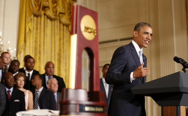 U.S. President Barack Obama talks about the 2014 NCAA champion UConn Huskies men's and women's basketball teams while in the East Room of the White House in Washington, June 9, 2014. REUTERS/Larry Downing (UNITED STATES - Tags: POLITICS SPORT BASKETBALL)