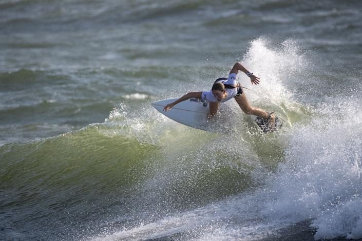 <p>South Africa's Bianca Buitendag rides a wave during the women's Surfing Third round at the Tsurigasaki Surfing Beach, in Chiba, on July 26, 2021 during the Tokyo 2020 Olympic Games. (Photo by Olivier MORIN / AFP)</p>