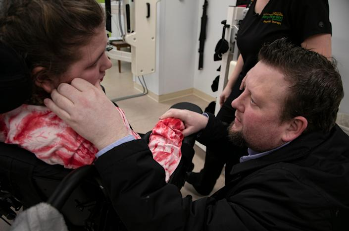 Bryan DeHart checks in with his daughter Savanah DeHart, 15, during her rehabilitation at the Mary Free Bed Rehabilitation Hospital in Grand Rapids Thursday, Jan. 23, 2020 to treat the debilitating effects of the Triple E virus. DeHart was likely bitten by a an infected mosquito last summer and suffered stroke-like symptoms.