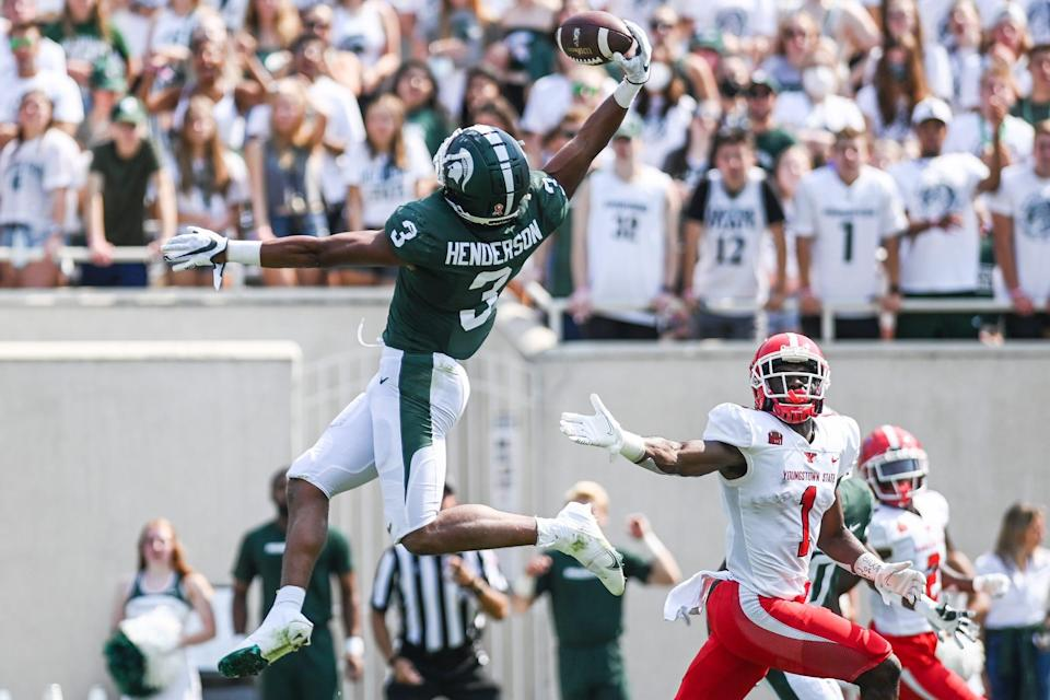 Michigan State's Xavier Henderson intercepts the ball intended for Youngstown State's Samuel St. Surin during the second quarter on Saturday, Sept. 11, 2021, at Spartan Stadium in East Lansing.