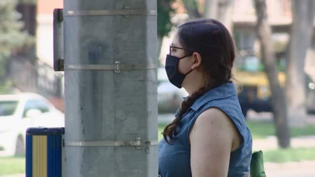 Some Regina and Saskatoon residents are still wearing masks even though the province lifted all public COVID-19 restrictions. (Germain Wilson/CBC - image credit)