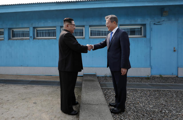 North Korean Leader Kim Jong Un and South Korean President Moon Jae-in shake hands over the military demarcation line during the Inter-Korean Summit on April 27, 2018, in Panmunjom, South Korea. (Photo: Inter Korean Press Corp/NurPhoto via Getty Images)