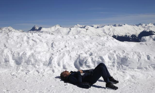 A man enjoys a sunny afternoon on top of the mountain of Rosa Khutor during the 2014 Sochi Winter Olympics, February 13, 2014. REUTERS/Leonhard Foeger (RUSSIA - Tags: SPORT OLYMPICS ENVIRONMENT)