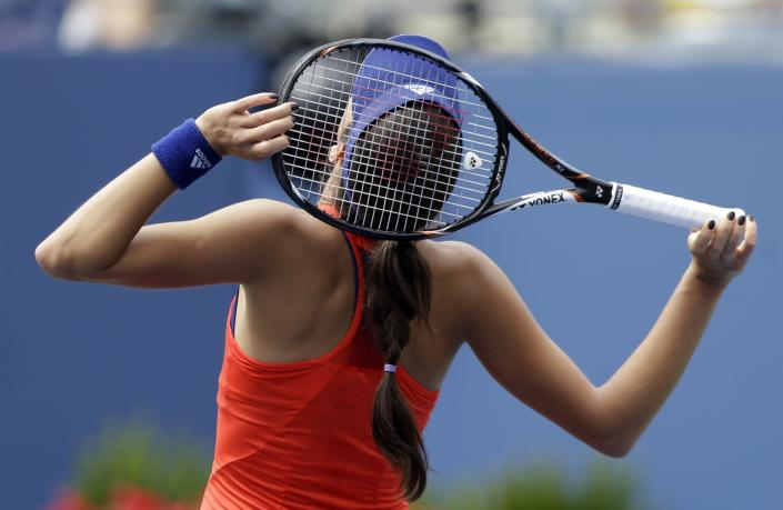Ana Ivanovic, of Serbia, reacts after losing a point to Victoria Azarenka, of Belarus, during the quarterfinals of the 2013 U.S. Open tennis tournament, Tuesday, Sept. 3, 2013, in New York. (AP Photo/Julio Cortez)