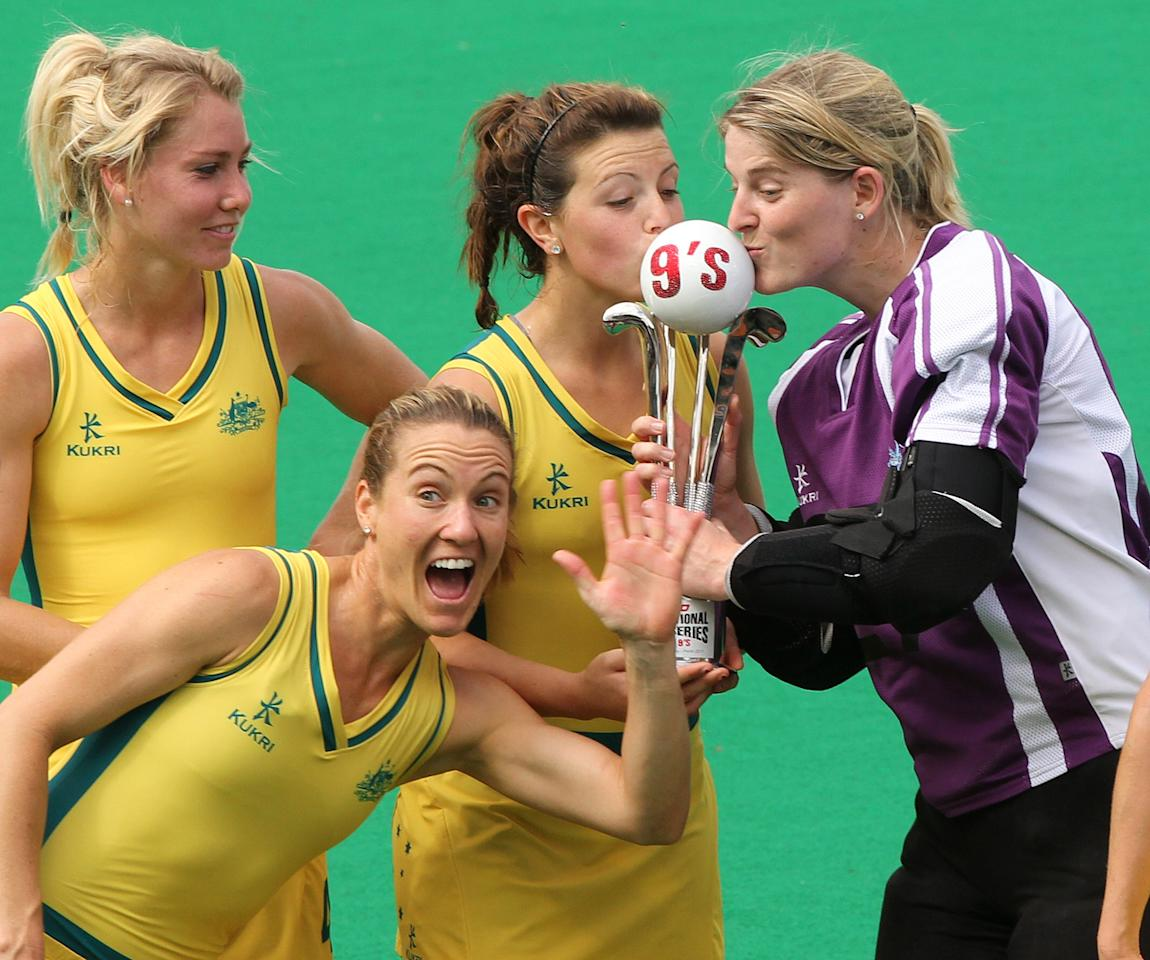 L-R: Australian team members Casey Eastham, Renee Trost, Kellie White and Rachael Lynch hold their trophy after defeating India in the womens final at the International Super Series hockey tournament in Perth on October 23, 2011. Australia won match the 4-1. RESTRICTED TO EDITORIAL USE NO ADVERTISING USE USE NO PROMOTIONAL USE NO MERCHANDISING. AFP PHOTO/TONY ASHBY (Photo credit should read TONY ASHBY/AFP/Getty Images)
