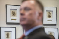 Portraits of former U.S. Secret Service Directors are seen behind U.S. Secret Service Director James Murray during an announcement of the release of the Secret Service National Threat Assessment Center's Protecting America's Schools report, in Washington, Thursday, Nov. 7, 2019. The report examines 41-targeted attacks that occurred in schools between 2008 and 2017. (AP Photo/Cliff Owen)