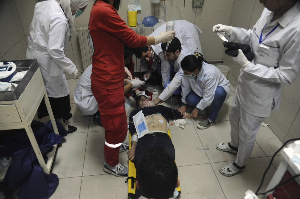 <p>In this photo released by the Syrian official news agency SANA, shows a man receiving treatment at a hospital in Damascus, Syria, Saturday, April. 7, 2018. (Photo: SANA via AP) </p>