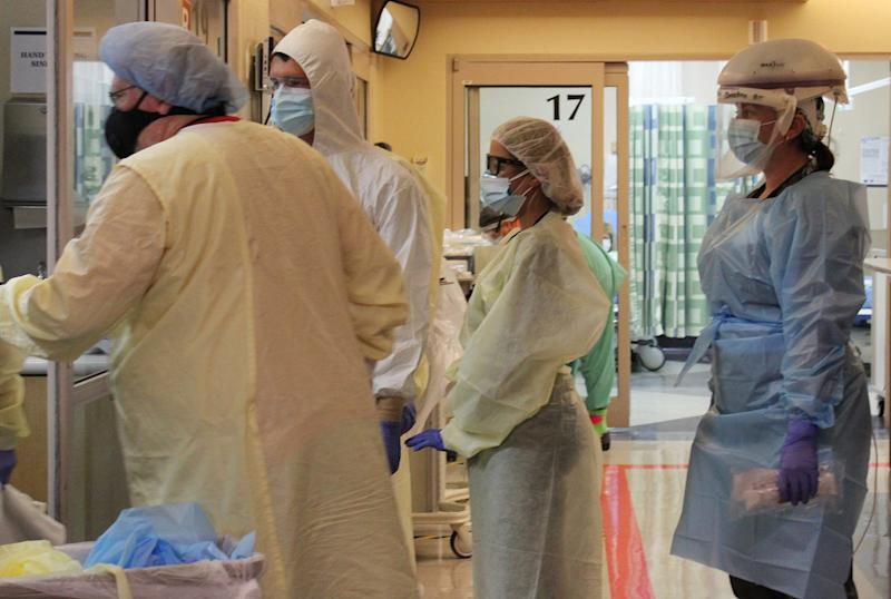 At Tucson Medical Center, caring for patients in the COVID-19 unit takes increased manpower; their stays are longer than other patients'.