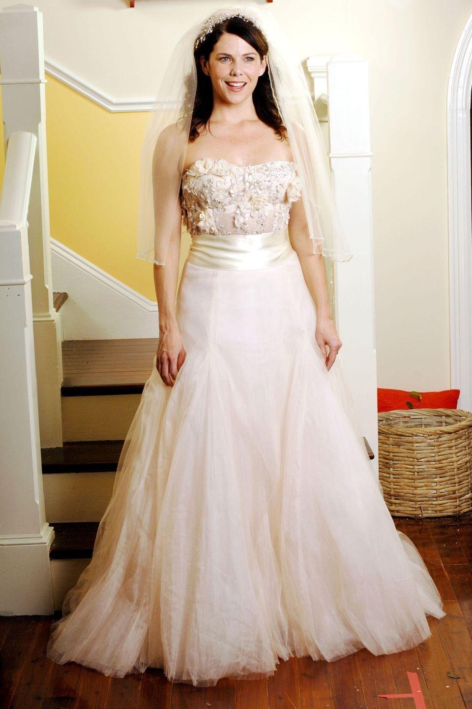 """<p>In a season 6 episode titled """"The Perfect Dress,"""" Lorelei attempts to find just that for her upcoming wedding to Luke. She goes dress shopping with Sookie and comes across the perfect blush satin dress with a flowered bodice — which also happened to be on sale!</p>"""