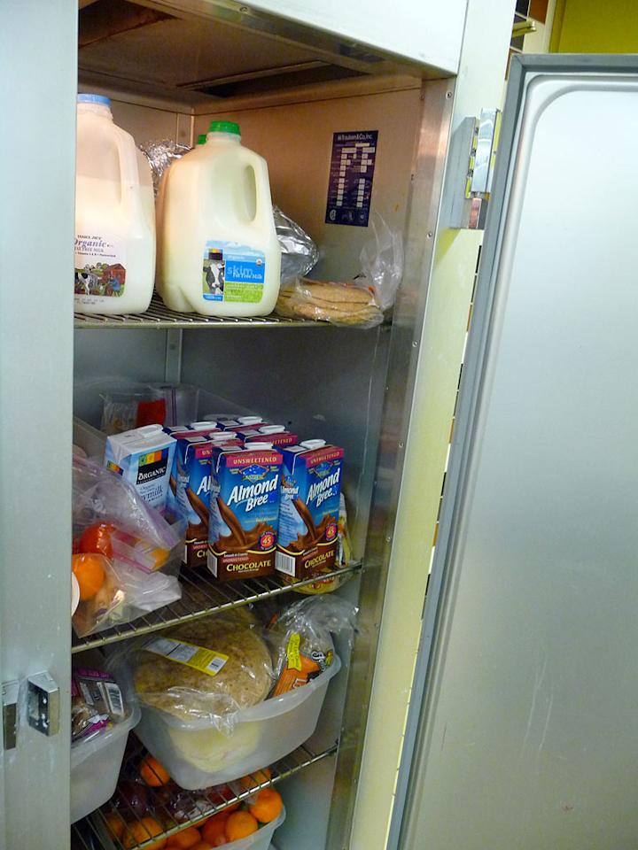 The fridge is wider than it looks in this picture, but I was struck by the number of soy milk cartons AND the number of oranges at the bottom. I have never seen so many oranges in my life!