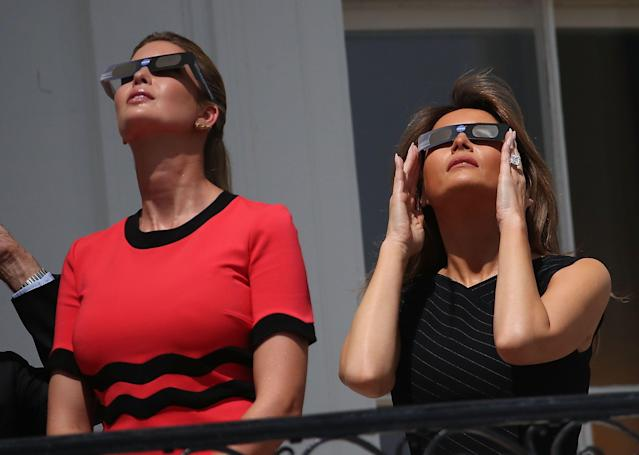 <p>To watch the solar eclipse on the White House balcony, Melania paired a slim-fitting black dress with a pair of protective eye glasses.</p>