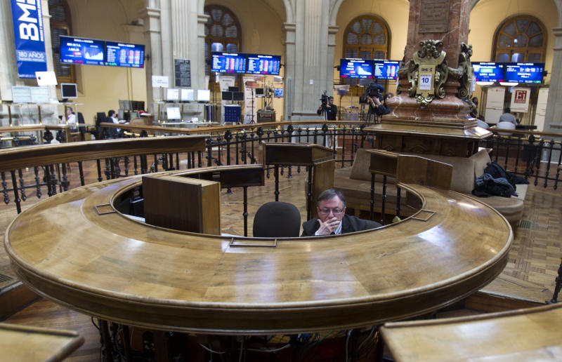 A broker sits in the stock exchange in Madrid Tuesday April 10, 2012. Worries about Spain's finances intensified Tuesday, when the country's bond yields on international markets rose despite expectations of a new round of austerity measures. The Spanish government is under intense pressure to show it can rekindle economic growth and cut its budget deficit to avoid becoming the next eurozone country to need a bailout, while the joblessness rate is 23 percent and the economy is shrinking(AP Photo/Paul White)