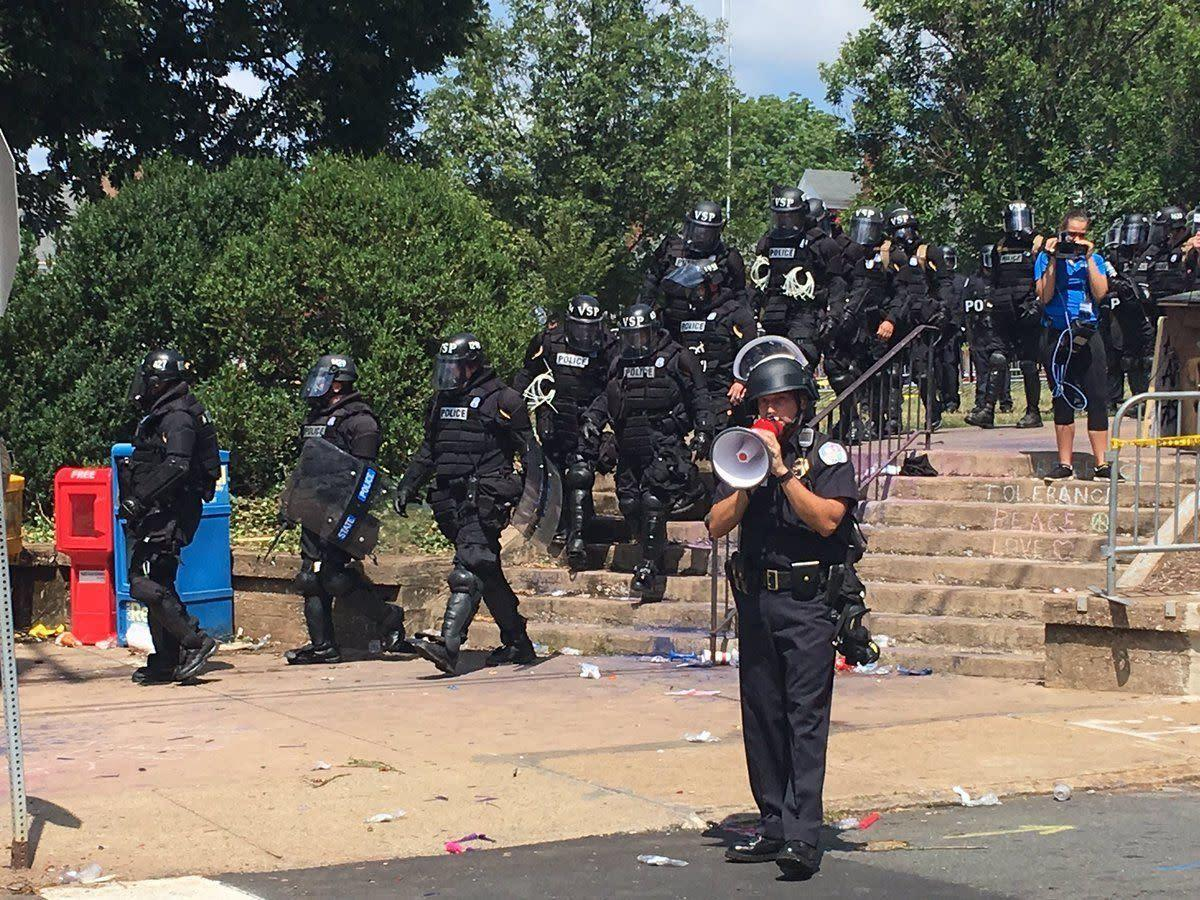 Police arrive at the scene of protestsafter a state of emergency is announced in Charlottesville, Virginia.