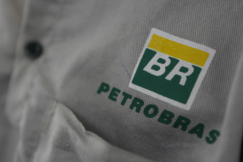 Petrobras logo in employee's uniform. Executives of Brazilian state oil company Petrobras and Bolivian counterpart YPFB signed this week a contract for a US$1.2 billion natural-gas exploration venture in southern Bolivia. (Photo by Diego Herculano/NurPhoto via Getty Images)