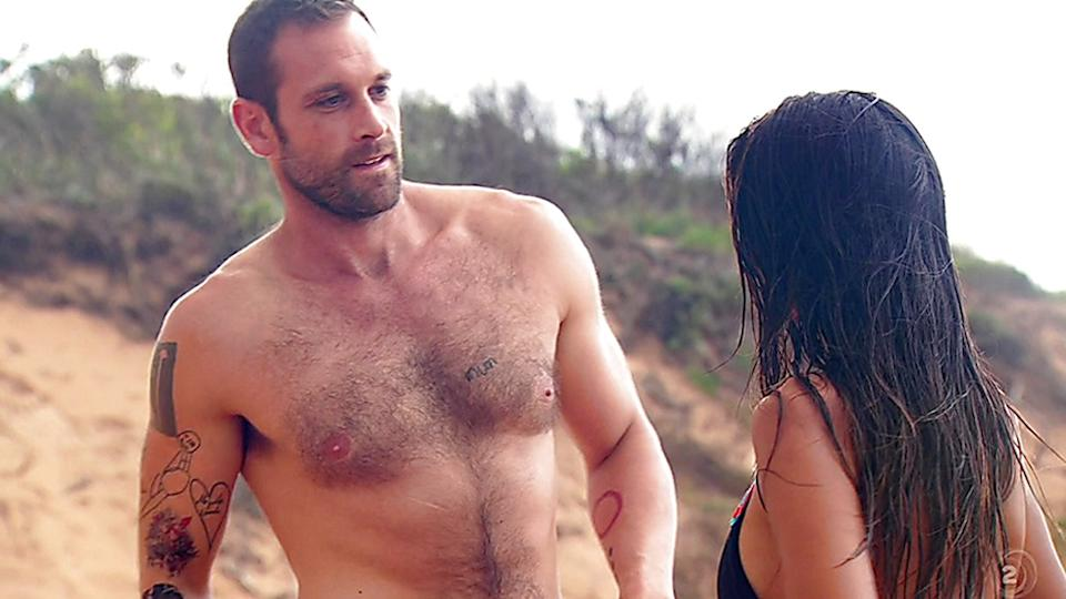 A photo of Home and Away star Jake Ryan shirtless on the Summer Bay beach set.