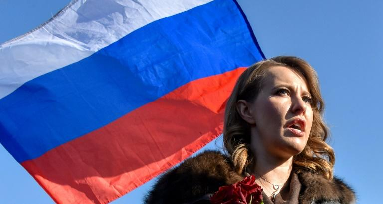 Putin's rival candidates hurl water and insults at presidential debate