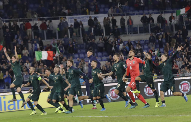 The Italian soccer team celebrates after the end of the Euro 2020 group J qualifying soccer match between Italy and Greece in Rome, Italy, Saturday, Oct. 12, 2019. Italy have qualified for Euro 2020, after defeating Greece 2-0. (AP Photo/Alessandra Tarantino)