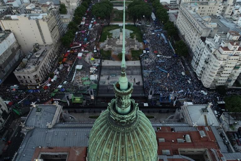 Aerial view showing anti-abortion activists (R) and abortion rights supporters (L) gathering outside the Argentine Congress as senators debate a landmark bill on whether to legalize abortion, in Buenos Aires, on December 29, 2020