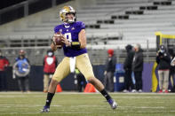 Washington quarterback Dylan Morris drops to pass against Utah during the second half of an NCAA college football game, Saturday, Nov. 28, 2020, in Seattle. (AP Photo/Ted S. Warren)