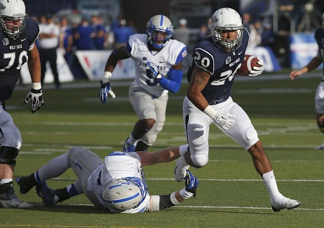Nevada's Chris Solomon (20) breaks a tackle from Air Force's Joey Nichol during the first half of an NCAA college football game in Reno, Nev., on Saturday, Sept. 28, 2013. (AP Photo/Cathleen Allison)