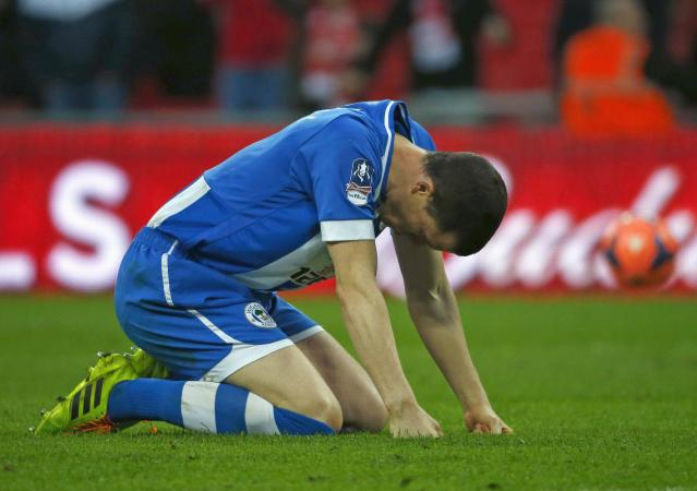 Wigan Athletic's Gary Caldwell reacts after their first penalty of a penalty shoot-out against Arsenal was saved, during their English FA Cup semi-final soccer match at Wembley Stadium in London April 12, 2014. REUTERS/Eddie Keogh (BRITAIN - Tags: SPORT SOCCER)