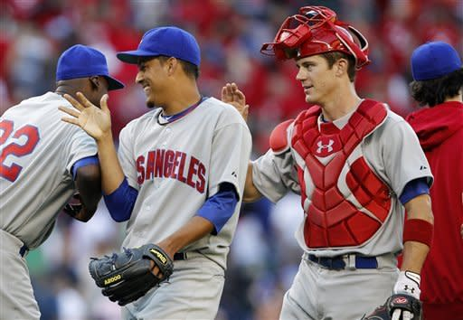 Los Angeles Angels closer Ernesto Frieri, left, and catcher Bobby Wilson celebrate with teammates after defeating the Seattle Mariners 5-3 in a baseball game, Saturday, May 26, 2012, in Seattle. (AP Photo/Elaine Thompson)