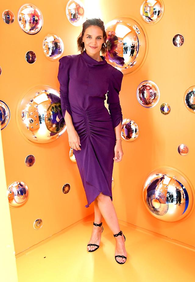 <p>Katie Holmes arrived at the A. Human exhibition's launch event in a violet-hued midi dress on September 4. <em>[Photo: Getty]</em> </p>