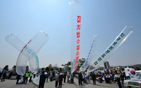 Balloons are still used, but smuggled flash drives enable more information to be spread across the borderCredit: KIM JAE-HWAN/AFP/Getty Images