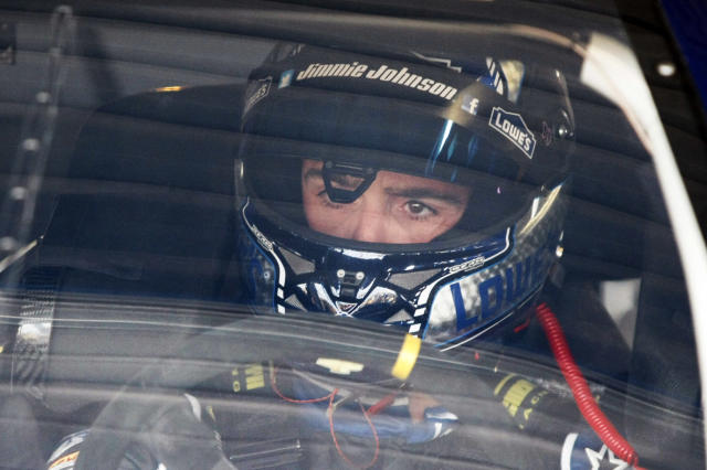 Driver Jimmie Johnson sits in his car before practice for Sunday's NASCAR Sprint Cup series auto race at Kansas Speedway in Kansas City, Kan., Friday, Oct. 4, 2013. AP Photo/Colin E. Braley)