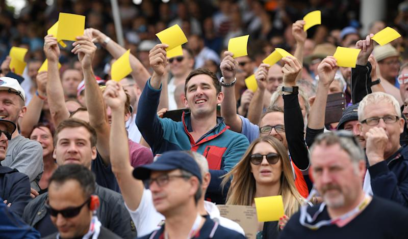 BIRMINGHAM, ENGLAND - AUGUST 01: England fans show off their yellow sandpaper during day one of the First Specsavers Ashes Test Match between England and Australia at Edgbaston on August 01, 2019 in Birmingham, England. (Photo by Stu Forster/Getty Images)