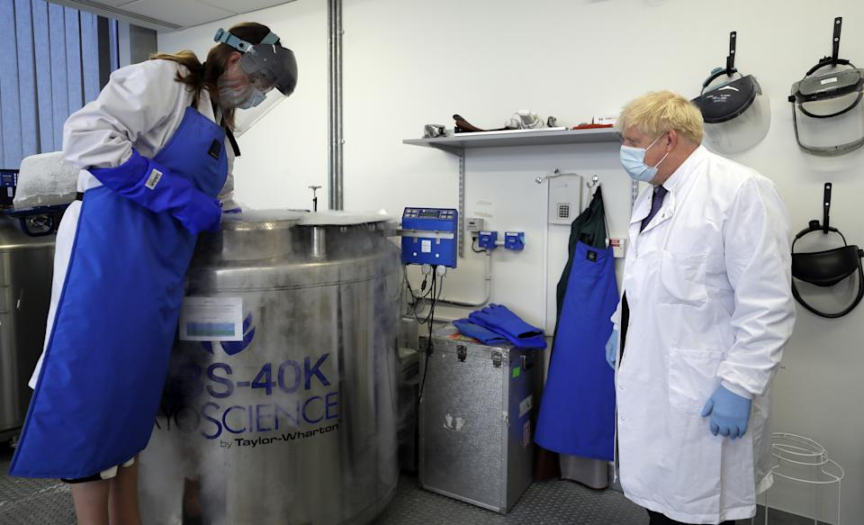 Prime Minister Boris Johnson is shown samples stored in liquid nitrogen by Professor Kate Ewer during a visit to the Jenner Institute in Oxford, where toured the laboratory and met scientists who are leading the COVID vaccine research.