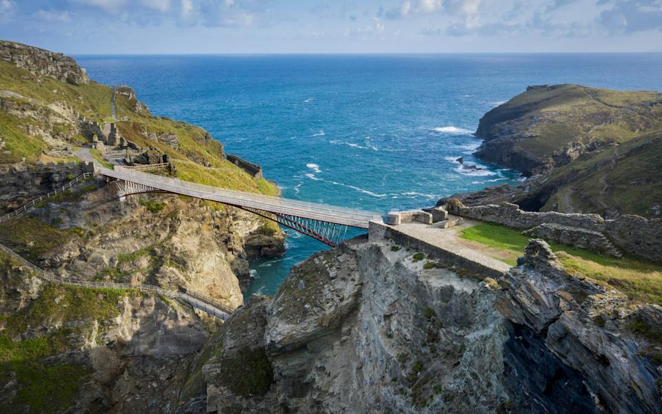 The new footbridge at Tintagel Castle soars above the sea and castle grounds - David Levene