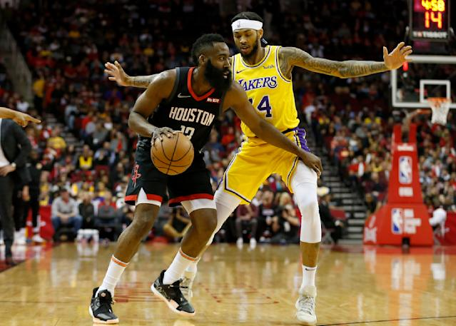 HOUSTON, TX - JANUARY 19: James Harden #13 of the Houston Rockets dribbles the ball defended by Brandon Ingram #14 of the Los Angeles Lakers in the first half at Toyota Center on January 19, 2019 in Houston, Texas. (Photo by Tim Warner/Getty Images)