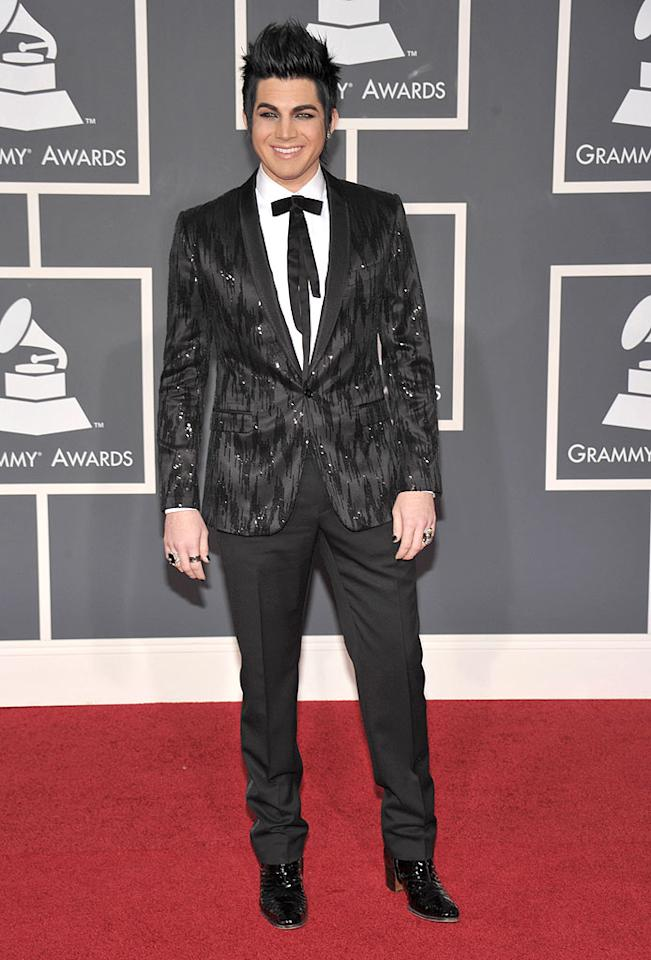 "Adam Lambert  Grade: D   The glam rocker delivered a bevy of fashion faux pas including caked-on makeup, a bedazzled blazer, a tacky bolo, excessive accessories, and heeled boots. John Shearer/<a href=""http://www.wireimage.com"" target=""new"">WireImage.com</a> - January 31, 2010"