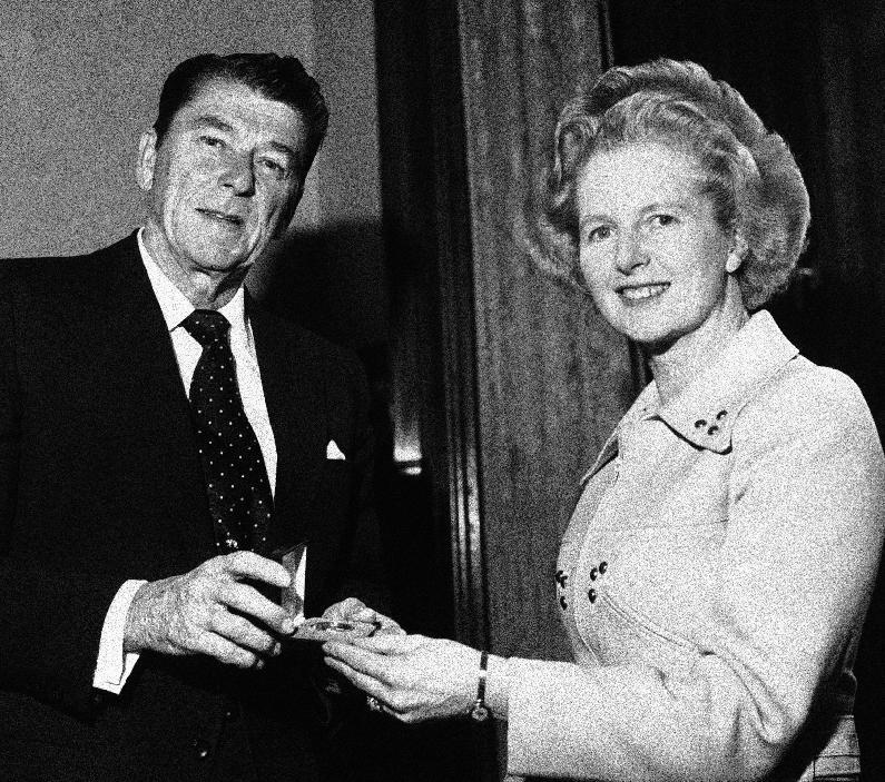 "FILE - In this April 9, 1975 file photo, former California Governor Ronald Reagan presents a silver dollar medallion to Opposition Leader Margaret Thatcher when he visited her office at the House of Commons in London. Ex-spokesman Tim Bell says that Thatcher has died. She was 87. Bell said the woman known to friends and foes as ""the Iron Lady"" passed away Monday morning, April 8, 2013. (AP Photo/File)"